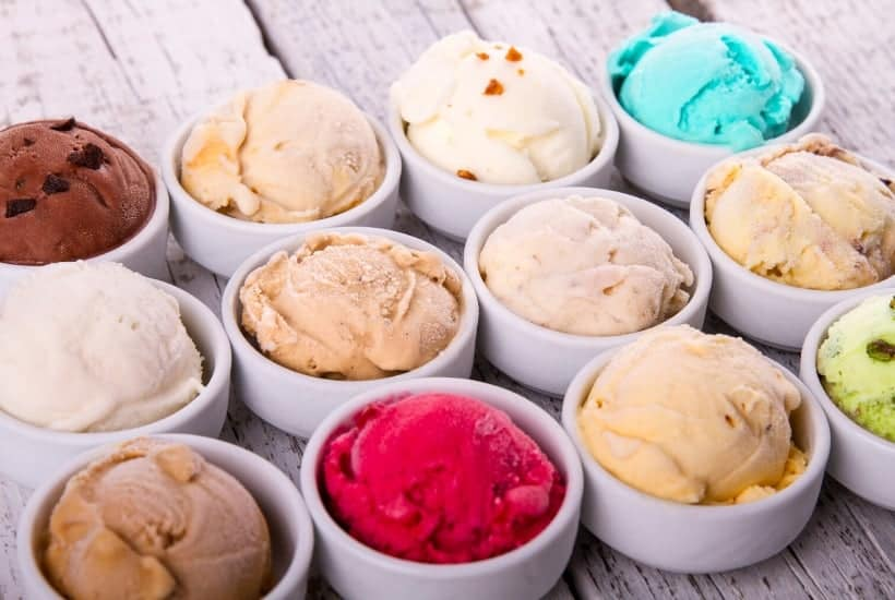 12 bowls of different ice cream while weighing the differences between dividend stocks vs mutual funds for dividend investing