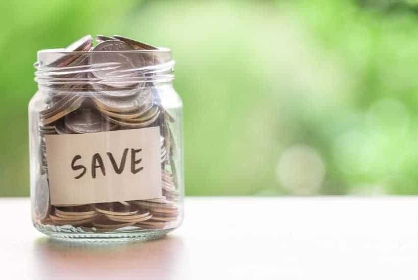 "Jar of coins with label ""Save"" while preparing to save money from your salary"
