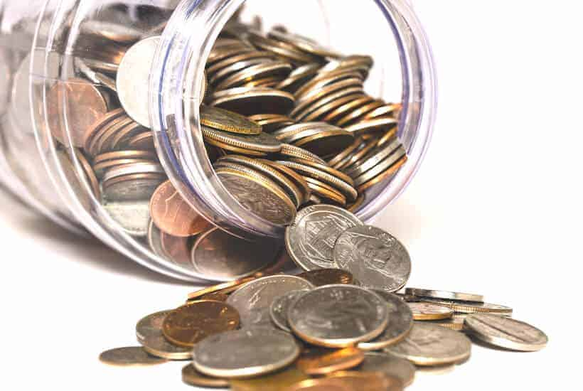 Jar of coins while setting up ideas for sinking funds