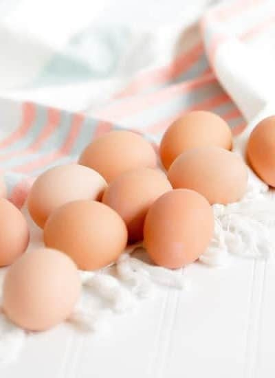 Brown eggs on a towel, one option from the Vitamin B12 Foods List