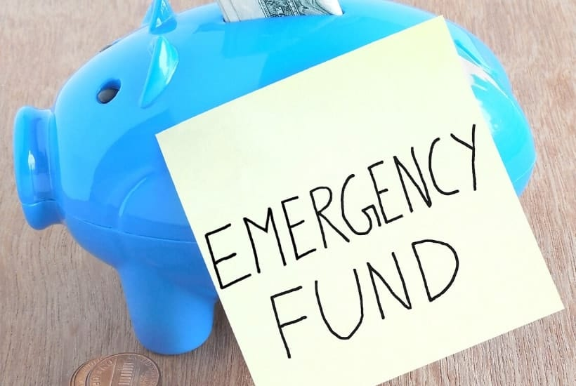 Blue piggy bank with emergency fund to explain why you need an emergency fund