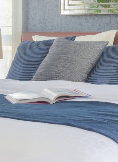 Photo a bed with a book on it while reading Is investing in stocks passive income