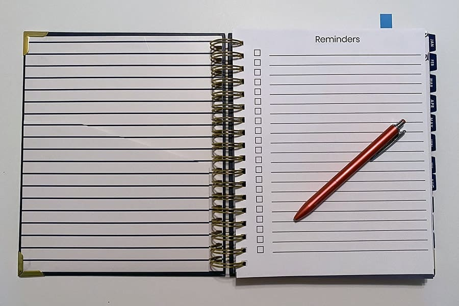 Living Well Planner with custom page added for a reminders checklist.