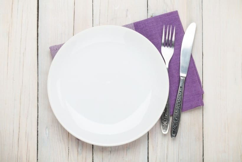 Empty white plate and fork when you're too tired to eat after work