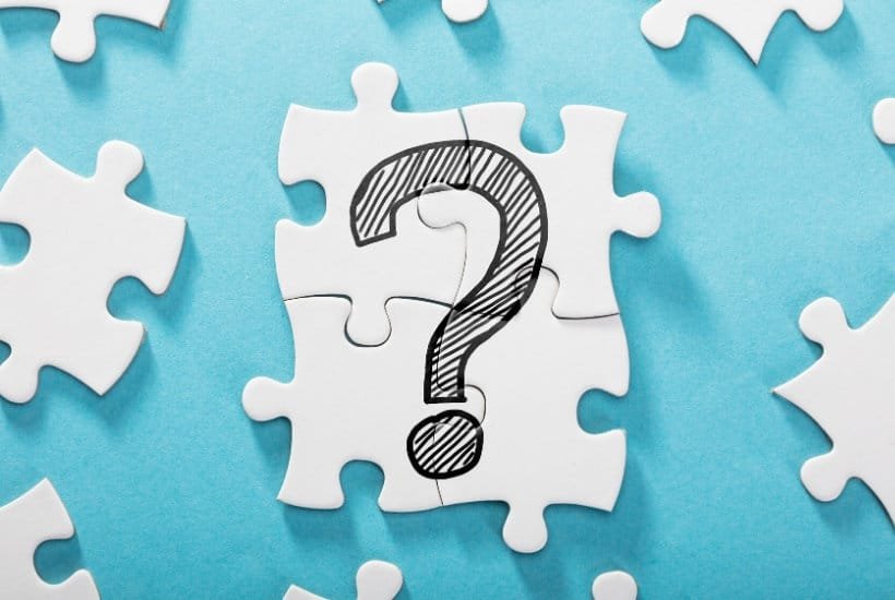 Puzzle pieces with a hand-drawn question mark to look at what is a dividend investor.
