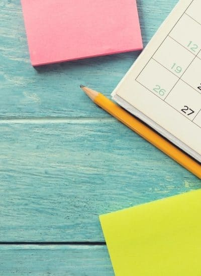 Calendar with post-it notes for creating a biweekly savings plan