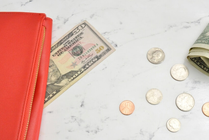 Wallet with coins as looking at Ebates Tips to save money