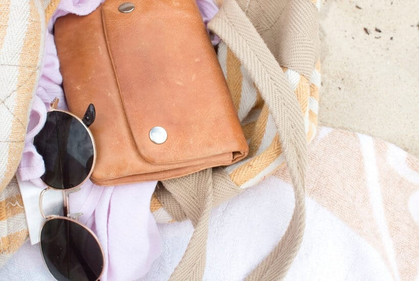 Handbag and sunglasses while considering how to save money using credit cards