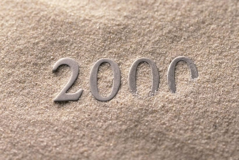 Metal 2000 partially covered in sand to represent planning a $2000 a month in dividends goal